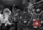 Image of decorated christmas tree and young girl with doll United States USA, 1951, second 6 stock footage video 65675032403