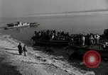 Image of Korean refugees ferrying across river Pyongyang North Korea, 1950, second 5 stock footage video 65675032638