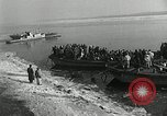 Image of Korean refugees ferrying across river Pyongyang North Korea, 1950, second 7 stock footage video 65675032638