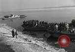 Image of Korean refugees ferrying across river Pyongyang North Korea, 1950, second 8 stock footage video 65675032638