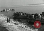 Image of Korean refugees ferrying across river Pyongyang North Korea, 1950, second 9 stock footage video 65675032638