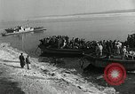 Image of Korean refugees ferrying across river Pyongyang North Korea, 1950, second 12 stock footage video 65675032638