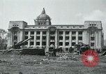 Image of 155mm howitzers next to capitol building Seoul South Korea, 1951, second 5 stock footage video 65675032641