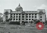 Image of 155mm howitzers next to capitol building Seoul South Korea, 1951, second 6 stock footage video 65675032641