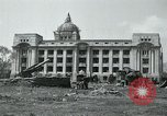 Image of 155mm howitzers next to capitol building Seoul South Korea, 1951, second 8 stock footage video 65675032641