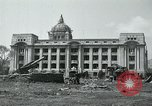 Image of 155mm howitzers next to capitol building Seoul South Korea, 1951, second 10 stock footage video 65675032641