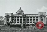 Image of 155mm howitzers next to capitol building Seoul South Korea, 1951, second 12 stock footage video 65675032641
