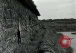 Image of thatch hut Vietnam, 1962, second 6 stock footage video 65675032664