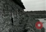 Image of thatch hut Vietnam, 1962, second 7 stock footage video 65675032664