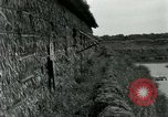 Image of thatch hut Vietnam, 1962, second 8 stock footage video 65675032664