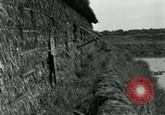 Image of thatch hut Vietnam, 1962, second 9 stock footage video 65675032664