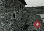Image of thatch hut Vietnam, 1962, second 10 stock footage video 65675032664