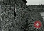 Image of thatch hut Vietnam, 1962, second 11 stock footage video 65675032664