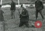 Image of troops Vietnam, 1962, second 7 stock footage video 65675032666