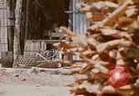 Image of villagers Vietnam, 1970, second 2 stock footage video 65675032672