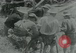 Image of Viet Cong moving supplies in Jungles on bicycles Vietnam, 1967, second 1 stock footage video 65675032692