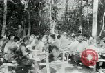 Image of Viet Cong political meeting at base in jungle Vietnam, 1965, second 2 stock footage video 65675032693