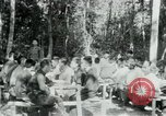 Image of Viet Cong political meeting at base in jungle Vietnam, 1965, second 4 stock footage video 65675032693