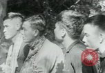 Image of Viet Cong political meeting at base in jungle Vietnam, 1965, second 8 stock footage video 65675032693