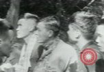 Image of Viet Cong political meeting at base in jungle Vietnam, 1965, second 9 stock footage video 65675032693
