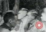 Image of Viet Cong political meeting at base in jungle Vietnam, 1965, second 10 stock footage video 65675032693