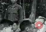 Image of Viet Cong political meeting at base in jungle Vietnam, 1965, second 12 stock footage video 65675032693