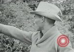Image of Vietcong points 45 caliber automatic pistol Vietnam, 1965, second 9 stock footage video 65675032696