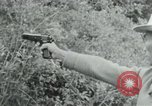 Image of Vietcong points 45 caliber automatic pistol Vietnam, 1965, second 11 stock footage video 65675032696