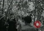Image of Vietnamese families carrying food and supplies into Viet Cong camp in  Vietnam, 1965, second 2 stock footage video 65675032697