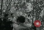 Image of Vietnamese families carrying food and supplies into Viet Cong camp in  Vietnam, 1965, second 3 stock footage video 65675032697