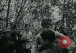 Image of Vietnamese families carrying food and supplies into Viet Cong camp in  Vietnam, 1965, second 5 stock footage video 65675032697
