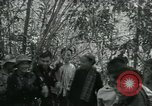Image of Vietnamese families carrying food and supplies into Viet Cong camp in  Vietnam, 1965, second 7 stock footage video 65675032697