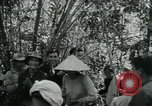 Image of Vietnamese families carrying food and supplies into Viet Cong camp in  Vietnam, 1965, second 11 stock footage video 65675032697