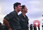Image of 1st Air Cavalry division replacements watching helicopter demonstratio Vietnam, 1971, second 11 stock footage video 65675032698