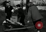 Image of People cleaning up a lot for use as a playground Monroe New York USA, 1950, second 8 stock footage video 65675032772
