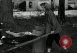 Image of People cleaning up a lot for use as a playground Monroe New York USA, 1950, second 10 stock footage video 65675032772