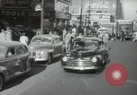 Image of New York City police car driving in midtown Manhattan New York City USA, 1939, second 4 stock footage video 65675032802