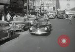 Image of New York City police car driving in midtown Manhattan New York City USA, 1939, second 7 stock footage video 65675032802