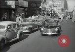 Image of New York City police car driving in midtown Manhattan New York City USA, 1939, second 10 stock footage video 65675032802