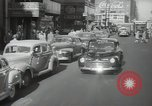 Image of New York City police car driving in midtown Manhattan New York City USA, 1939, second 11 stock footage video 65675032802
