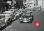 Image of New York City police car driving in midtown Manhattan New York City USA, 1939, second 12 stock footage video 65675032802