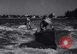 Image of Santa Claus on water skis Miami Florida USA, 1937, second 5 stock footage video 65675032891