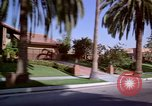 Image of Palm tree lined street in neighborhood Los Angeles California USA, 1976, second 11 stock footage video 65675033263