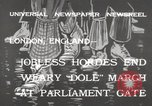 Image of unemployed people march through Great Yarmouth London England United Kingdom, 1932, second 2 stock footage video 65675033280