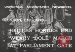 Image of unemployed people march through Great Yarmouth London England United Kingdom, 1932, second 5 stock footage video 65675033280