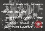 Image of unemployed people march through Great Yarmouth London England United Kingdom, 1932, second 6 stock footage video 65675033280