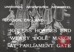 Image of unemployed people march through Great Yarmouth London England United Kingdom, 1932, second 8 stock footage video 65675033280