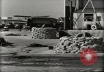 Image of Wrecked Planes Hangars and Ships Pearl Harbor Hawaii USA, 1942, second 11 stock footage video 65675033414