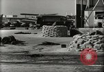 Image of Wrecked Planes Hangars and Ships Pearl Harbor Hawaii USA, 1942, second 12 stock footage video 65675033414
