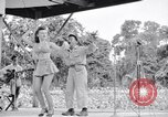 Image of Patti Thomas of Bob Hope U.S.O.troupe entertains troops  Bougainville Solomon Islands, 1944, second 1 stock footage video 65675033575